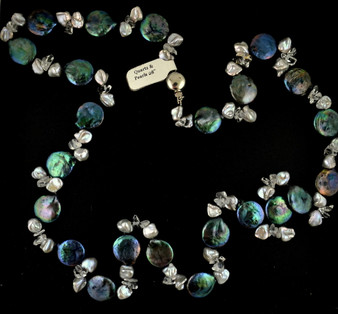 28 inch necklace with blue green coin pearls, irregular gray freshwater pearls, and quartz, with a sterling silver clasp. Strand is individually knotted between each pearl for greater security.
