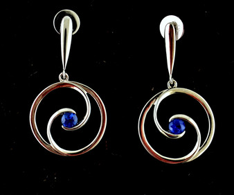 Silver post earrings with round swirl design, each with a single blue sapphire, 0.5 carat total weight for both stones. Michael Couch design.