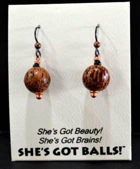 "Each pair of our wooden balls consists of genuine carved palm wood on French wires, accompanied by our delightfully tacky packaging. Our balls come mounted on this card, with the inscription ""She's Got Beauty! She's Got Brains! She's Got Balls!"""