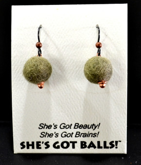 "Each pair of fuzzy balls are made of genuine wool on French wires, accompanied by our delightfully tacky packaging. Our balls come mounted on this card, with the inscription ""She's Got Beauty! She's Got Brains! She's Got Balls!"""
