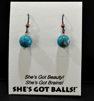 "Each pair of turquoise colored balls consists of turquoise colored magnesite on French wires, accompanied by our delightfully tacky packaging. Our balls come mounted on this card, with the inscription ""She's Got Beauty! She's Got Brains! She's Got Balls!"""