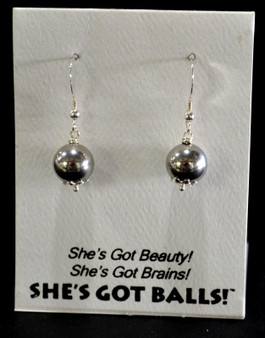 "Each pair of steel  balls consists of stainless steel on French wires, accompanied by our delightfully tacky packaging. Our balls come mounted on this card, with the inscription ""She's Got Beauty! She's Got Brains! She's Got Balls!"""