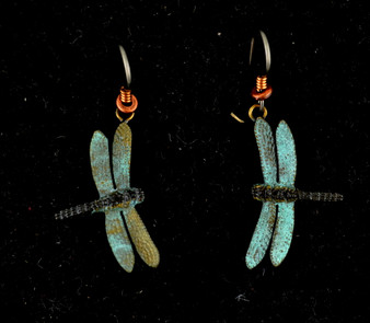 "Cavin Richie's carving reveals the delicate wing structure of this dragonfly captured in mid-flight. The earring hooks are made from gray niobium (hypoallergenic) with heishi beads and coils. The earrings are 1"" from wingtip to wingtip, cast in lightweight artist's bronze. Casting was created from one of Cavin's original shed-elk antler or woolly mammoth ivory carvings, to give the finished product more natural detail than is possible with a wax carving. Cast in the USA and hand finished in Washington State."