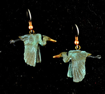 "Cavin Richie flying heron earrings on French wires, cast in lightweight artist's bronze, 0.72"" X 1.2"".  The earring hooks are made from gray niobium (hypoallergenic) with heishi beads and coils.  Casting was created from one of Cavin's original shed-elk antler or  woolly mammoth ivory carvings, to give the finished product more natural detail than is possible with a wax carving. Cast in the USA and hand finished in Washington State."