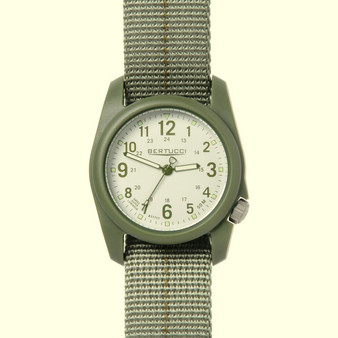 This Bertucci DX3 Plus Watch features unmatched performance and value. With classic Bertucci styling and a rugged design, this affordable field watch has a poly resin and fiber body with a stainless-steel crown and back, artistically sculpted and water resistant to 150 feet.  Beautifully designed in the heart of Chicago, every Bertucci watch is perfect for any occasion whether it's a hunting trip in the Northwoods or an elegant dinner engagement. Stone dial with olive numerals, drab band with olive striping. Three year warranty. #11081