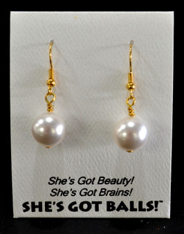 "Each pair of white balls consists of high quality created Swarovski pearls on French wires, accompanied by our delightfully tacky packaging.  Our balls come mounted on this card, wit the inscription ""She's Got Beauty! She's Got Brains! She's Got Balls!"""