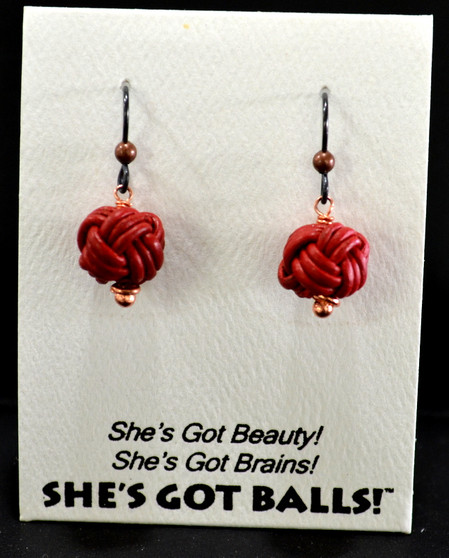 """Each pair of black leather balls consists woven leather on French wires, handcrafted especially for The Northwoods Goldsmith in the Netherlands, and are  accompanied by our delightfully tacky packaging.  Our balls come mounted on this card, with the inscription """"She's Got Beauty! She's Got Brains! She's Got Balls!"""""""