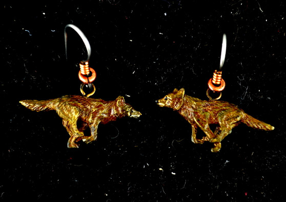 "Cavin Richie running wolf earrings on French wires, cast in lightweight artist's bronze, 0.04"" X 1.0"".  The earring hooks are made from gray niobium (hypoallergenic) with heishi beads and coils.  Casting was created from one of Cavin's original shed-elk antler or  woolly mammoth ivory carvings, to give the finished product more natural detail than is possible with a wax carving. Cast in the USA and hand finished in Washington State."