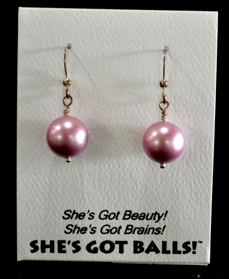 """Each pair of pink balls consists of high quality created Swarovski pearls on French wires, accompanied by our delightfully tacky packaging. Our balls come mounted on this card, with the inscription """"She's Got Beauty! She's Got Brains! She's Got Balls!"""""""