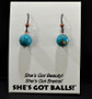 """Each pair of turquoise colored balls consists of turquoise colored magnesite on French wires, accompanied by our delightfully tacky packaging. Our balls come mounted on this card, with the inscription """"She's Got Beauty! She's Got Brains! She's Got Balls!"""""""