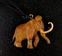 """Cavin Richie design woolly mammoth pendant, cast in lightweight artist's bronze, 1.5"""" X 1.2 """". The fabric cord is adjustable from 18 to 36 inches. Casting was created from one of Cavin's original shed-elk antler or  woolly mammoth ivory carvings, to give the finished product more natural detail than is possible with a wax carving. Cast in the USA and hand finished in Washington State."""