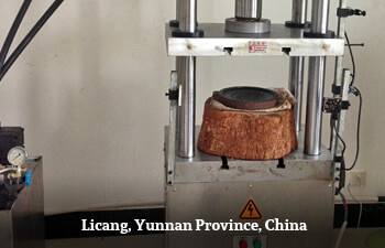 pneumatic-pu-erh-press-in-yunnan-china.jpg