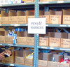 5x7 DocU-Sleeve in use labeling warehouse shelves