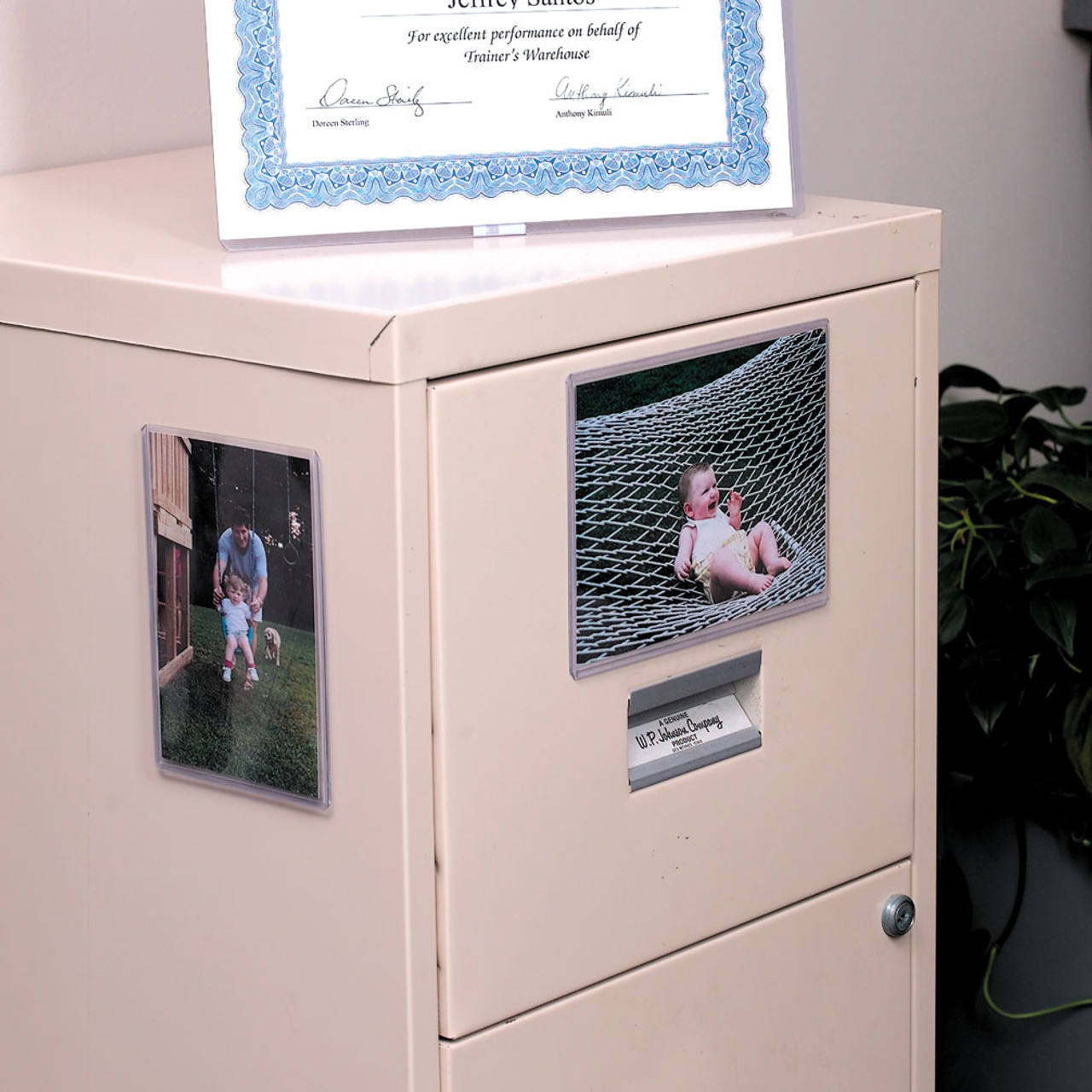 4x6 DocU-Sleeves protecting photos, shown on a filing cabinet