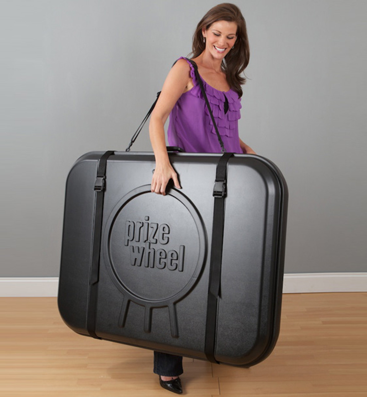 Travel Case for 31-inch Prize Wheel; carried by woman
