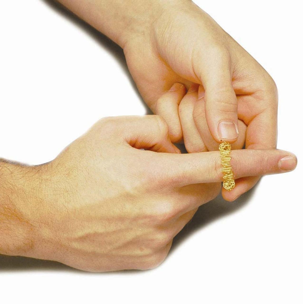 Figit Finger Massager; on finger