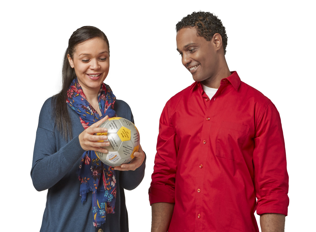 Woman and man using Onward and Upward Thumball