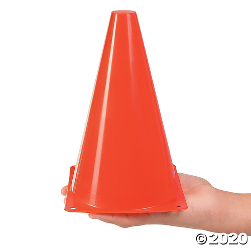 Small red traffic cone in hand