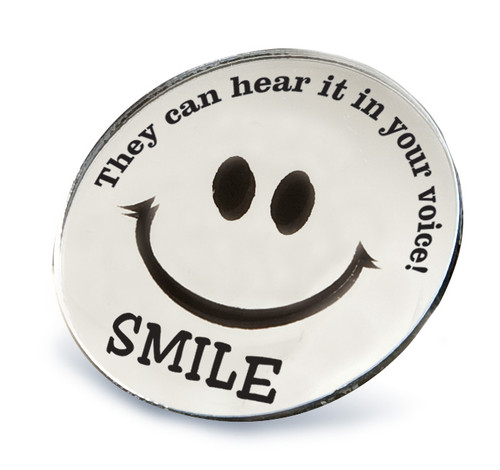 "Round Smile Mirror imprinted with ""SMILE. They can hear it in your voice."""