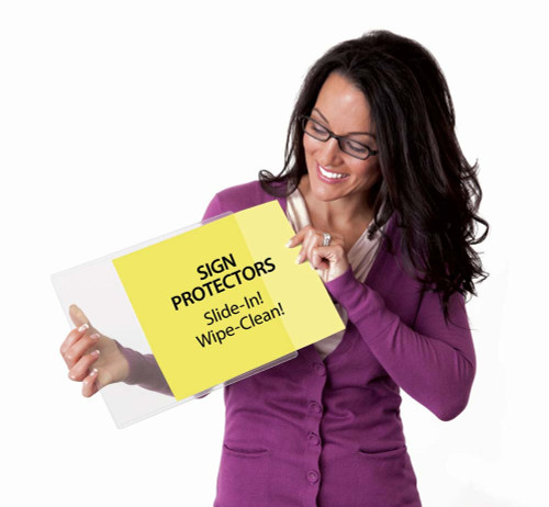 Woman holding 8.5x11 DocU-Sleeve and sliding in a sign