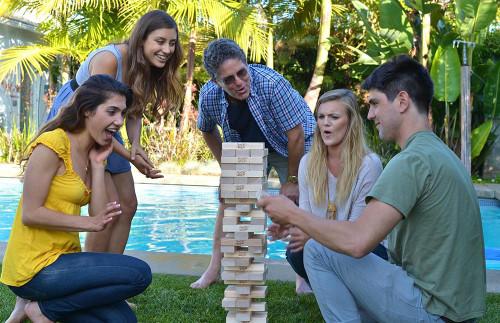 Adults playing Giant Jenga