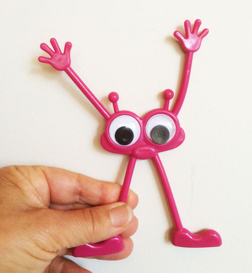 Googly Eyes Monster Bendables; one in hand