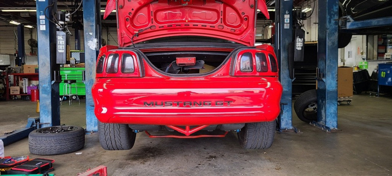 94-04 Mustang Rear Bash Bar in Red with rear bumper cover installed.
