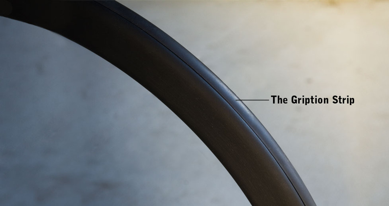 The Gription Strip䋢 is a rubber strip that goes all the way around the top surface of the oval handrim.  The Gription Strip is particularly helpful when going up ramps, hills, or when traversing difficult surfaces (e.g., like deep-pile carpeting). Smooth side surface means no-burn braking.