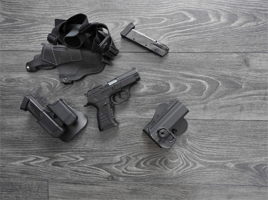 bigstock-gun-black-spare-magazines-and-318695317.jpg