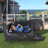 Brawny Black Bear Bench Sculpture in the yard