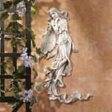 Brianna the Summer Breeze Fairy Wall Sculpture in the Garden