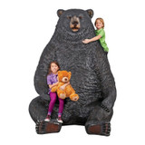 Sitting Pretty Oversized Black Bear Statue with Paw Seat With Kids Sitting on It