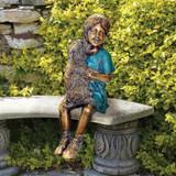 Puppy Kisses Sitting Girl Bronze Statue in the Garden