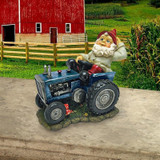 Plowing Pete on His Tractor Garden Gnome Statue in the Garden