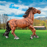 Unbridled Running Wild Mustang Horse Statue in the Yard