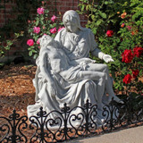 Pieta Bonded Marble Statue in the Garden by Roses
