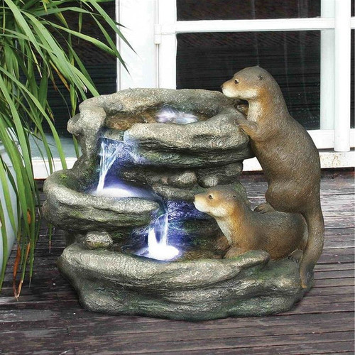 Bright Waters Otters Water Fountain Sculpture in the Garden