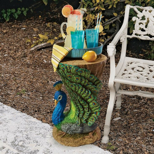 Provocative Peacock Sculptural Garden Table Next To Patio Furniture