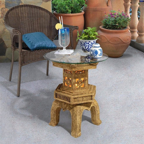 Tranquil Pagoda Illuminated Glass-Topped Plant Stand on the Patio