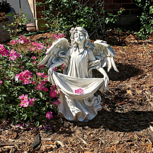Angel Bearing Gifts Garden Statue in the Garden