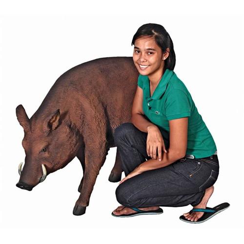 Life-Size Razorback Wild Boar Statue Next to Gardener