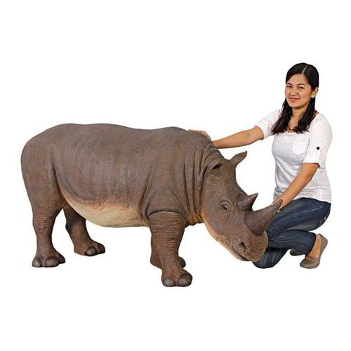 Grand-Scale Rhinoceros Statue With Gardener