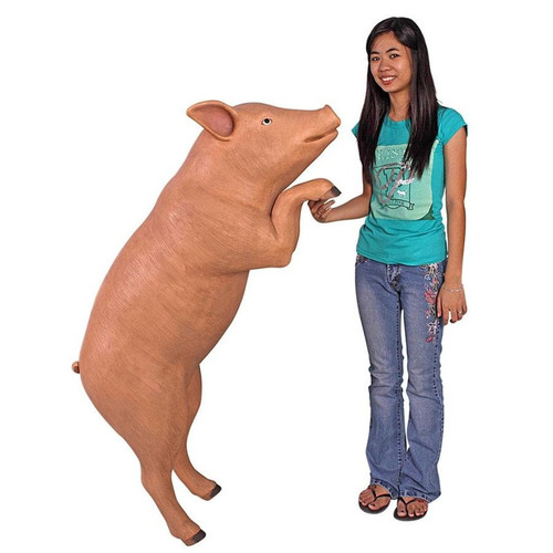 Hop Over Hog Giant Pig Animal Statue next to Gardener
