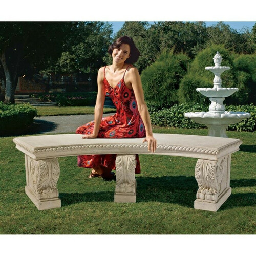 The Salentino Crescent Garden Bench By a Water Fountain