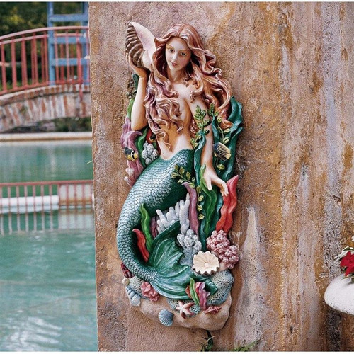 Melody Cove Mermaid Wall Sculpture in the Garden