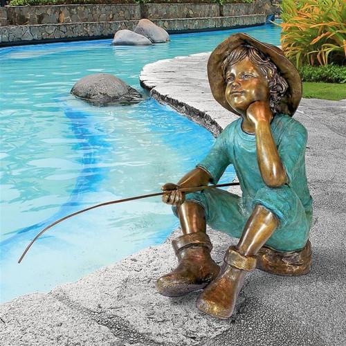 Fish Wish Fisherboy Cast Bronze Garden Statue on the Patio