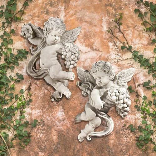 Cherub Harvest Wall Sculptures in the Garden