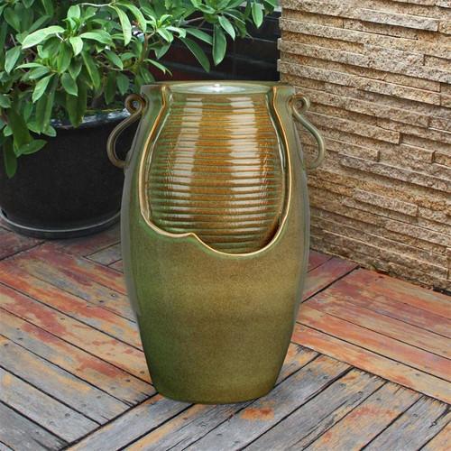 Ceramic Rippling Jar Water Fountain in the Garden