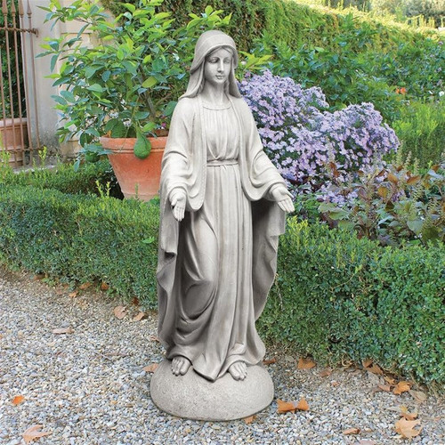 Madonna of Notre Dame Garden Statue in the Garden by Boxwoods and Hydrangeas