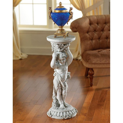 Sous la Vigne Cherub Plant Stand With Stone Finish in the Dining Room